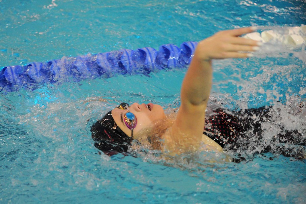 Mountlake Terrace's Victoria Loughe competes in the 100 backstroke at the Edmonds District championships Saturday at Lynnwood Pool.