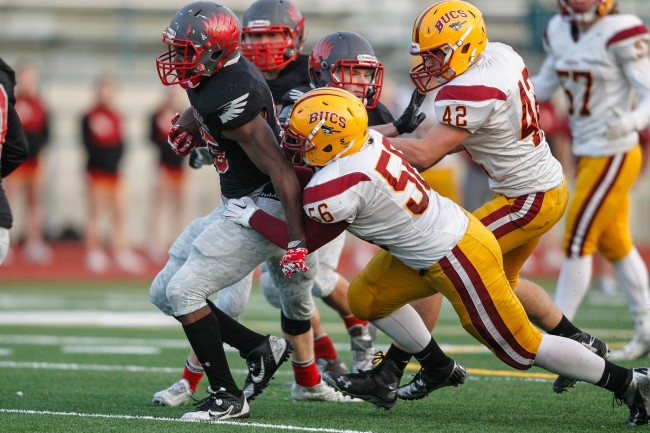 Mountlake Terrace's ordan Bishop (left) tries to escape the grasp of Kingston's Colin Sindel. (Photo by Jonah Wallace)