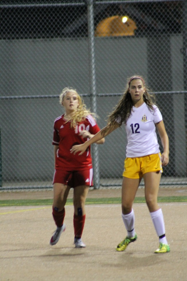 Mountlake Terrace's Maddie Powers (left) and Everett's Alexa Goetz wait for a throw-in. Powers had the game-winning goal for the Hawks in the 3-2 victory.