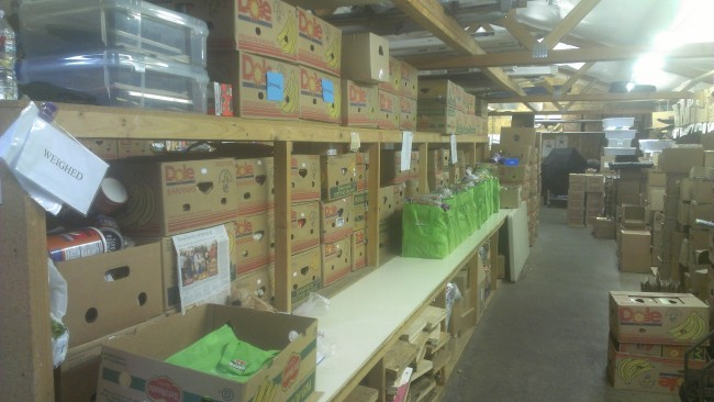Supply shelves at the food bank after a recent shipment of donations.
