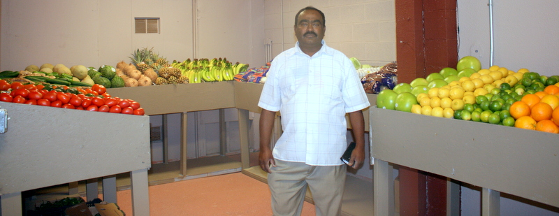 Paradise Market owner Moammed Yusuf stands i the fresh fruit and vegetable section.