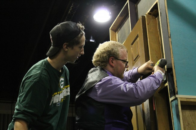 Cole Krause (left) and Kyle Henderson work on the set to be used for the Wait Until Dark production at MTHS this week.