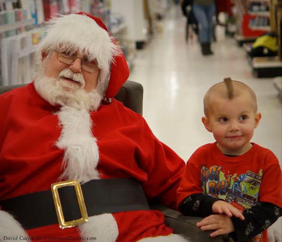 Santa with his first fan in line.