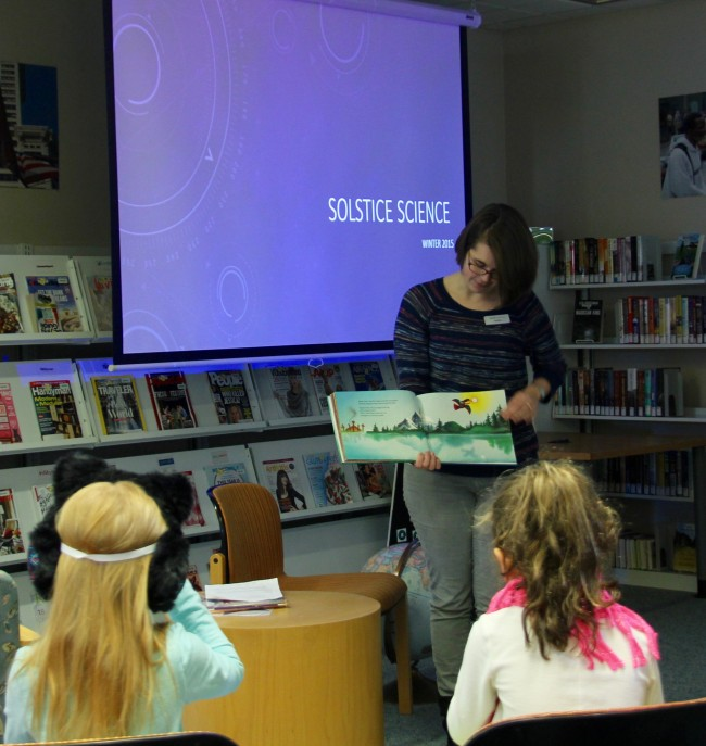 "Brier librarian Heather Orsen reads from the children's book ""Raven"" to explain why it's dark in the winter."
