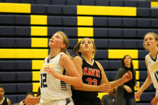 Sydney Taggart (left) and Jorie Lambert (right) battle for position under the boards,