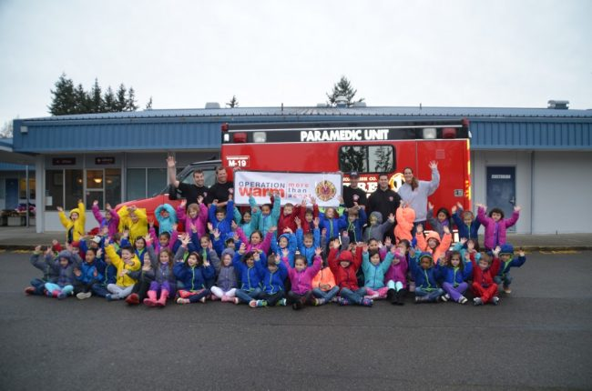 Firefighters with Mountlake Terrace Elementary students and their new jackets in January 2016. (Photo by Natalie Covate)