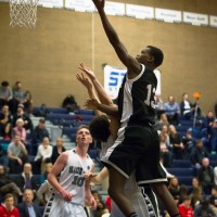 Terrace's Daniel Johnson flies into a Grizzlies defender on his way to the basket Tuesday.