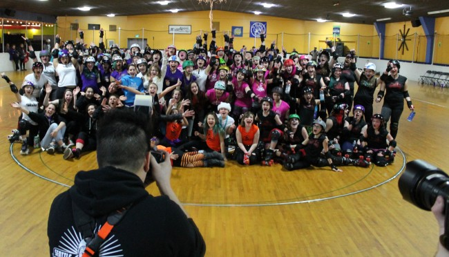 Seattle Derby Brats skaters pose for group photos during their Dec. 12 Winter Bout in Everett.