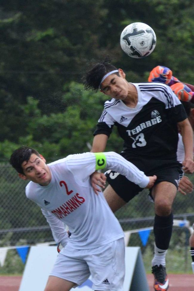 Mountlake Terrace's Diego Aquiniga jumps past Marysville-Pilchuck's Baruc Galvan to head the ball in for the only goal.