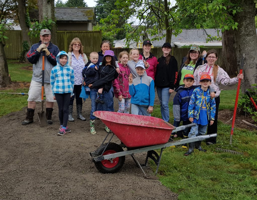 Members and leaders of Girl Scout Troop 43752 - with the assistance of two scouts from Cub Scout Pack 76 - pose along the portion of a new walking trail that they installed Saturday in Mountlake Terrace's Matt Hirvela Bicentennial Park. (Photo by Brandy LeBlanc)