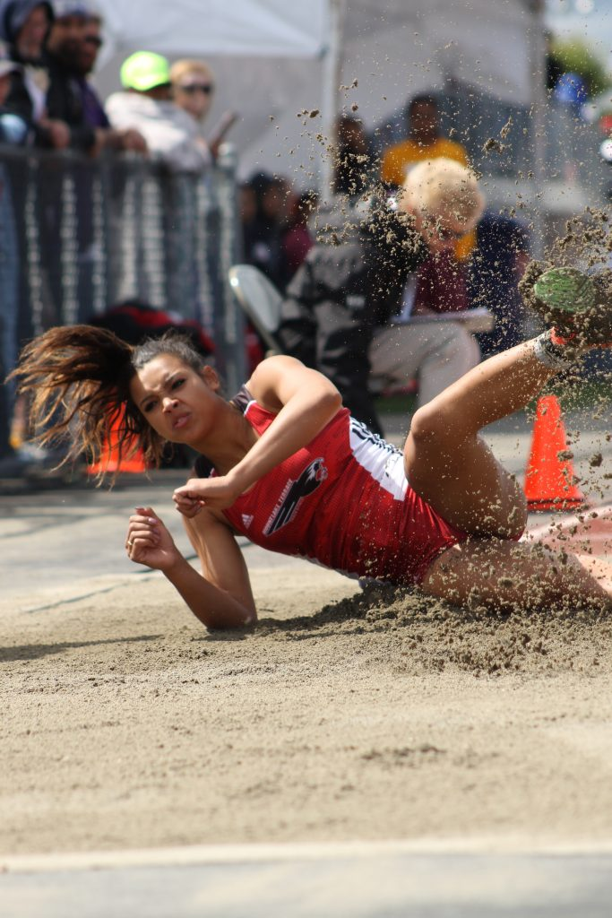 Mountlake Terrace's Chinne Okoronkwo won the 3A Girls Long Jump competition with a new state meet record leap of 19-03.25.