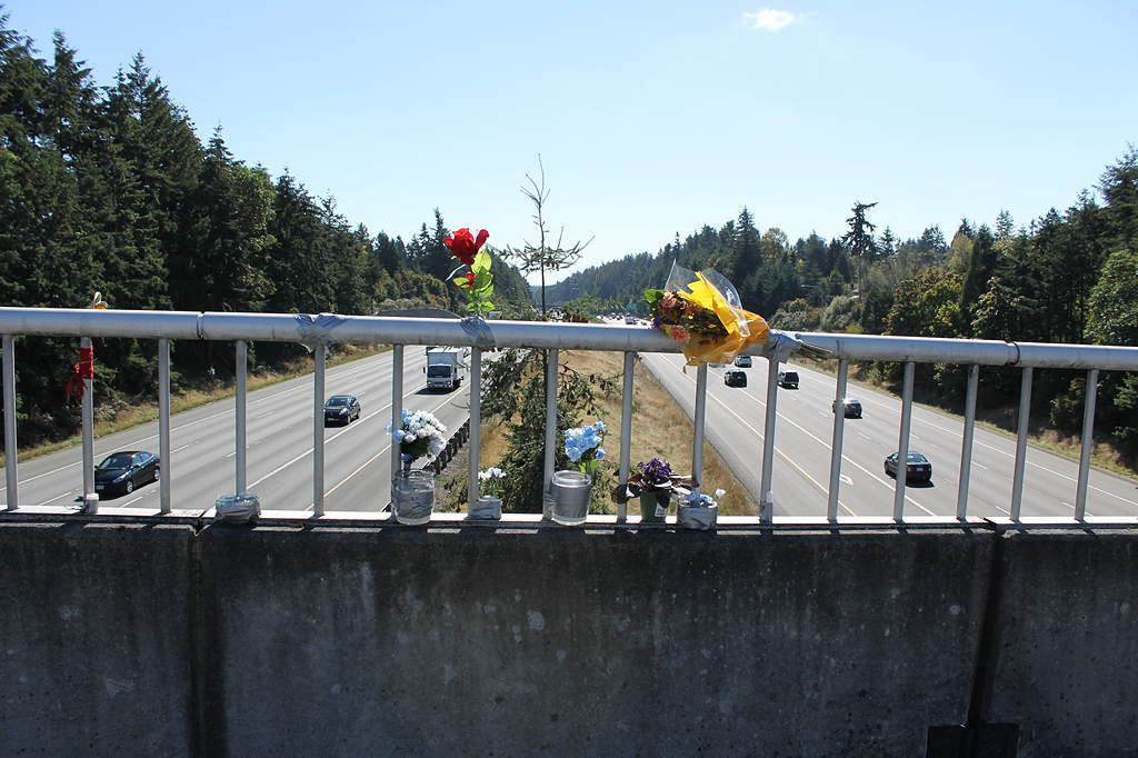 Flowers and candles make up a small but growing memorial on the 220th Street I-5 overpass in Mountlake Terrace. The body of Erique J. Tharpe, 23, of Mountlake Terrace was found below the overpass on Sept. 14. The Washington State Patrol believe Tharpe died from injuries sustained when he fell from the overpass onto the freeway. No official cause of death has been announced.