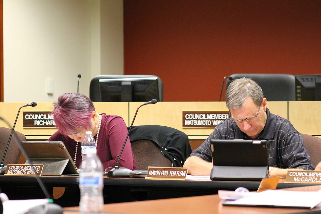 Mountlake Terrace City Council member Kyoko Matsumoto Wright (left) and Mayor Pro Tem Rick Ryan focus on the fine print in the 2017-2018 Revenue Estimates during the Sept. 15 city council work/study session.