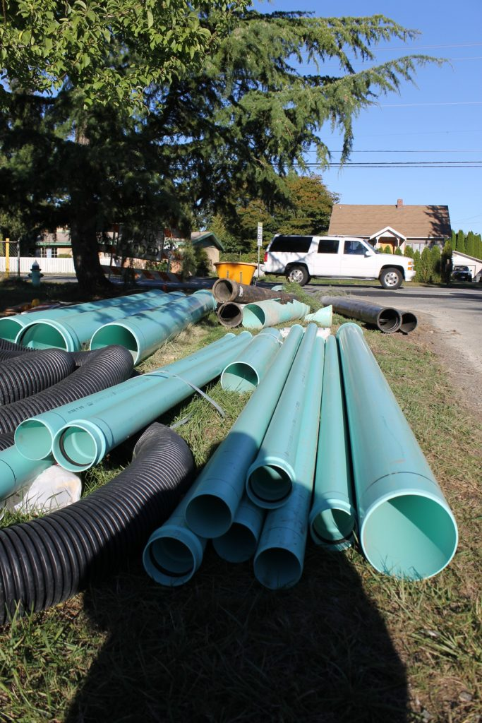 Construction supplies await as work to replace and upgrade water main, sewer and storm drain piping beneath and around 44th Avenue West and 224th Street Southwest in Mountlake Terrace continues this week. (Photo by Doug Petrowski)