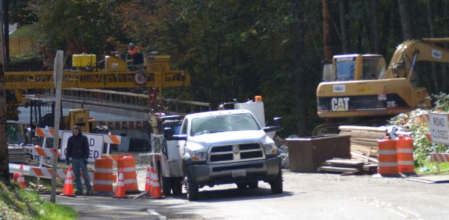 Crews work on the Locust Way bridge on Monday afternoon. (Photo by Natalie Covate)
