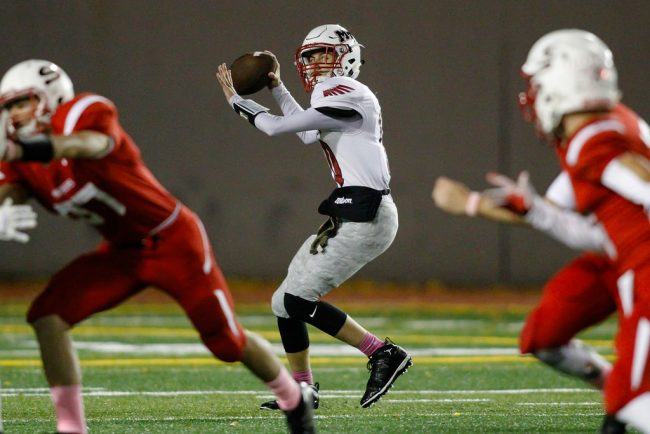 The Hawks' Jesse James Martineau looks for a big completion against the Snohomish Panthers. (Photo by Jonah Wallace)