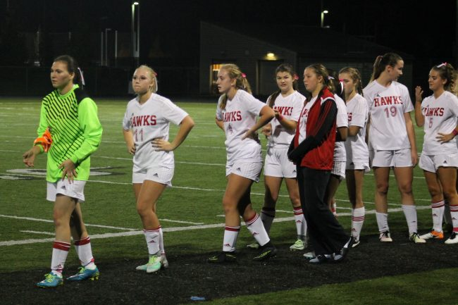 The Mountlake Terrace Hawks girls soccer team lines up to congratulate their opponent, the Arlington Eagles, following their match Tuesday night at Lynnwood High School. The Hawks were shut out by the Eagles 4-0 in the Wesco League clash. (Photo by Doug Petrowski)