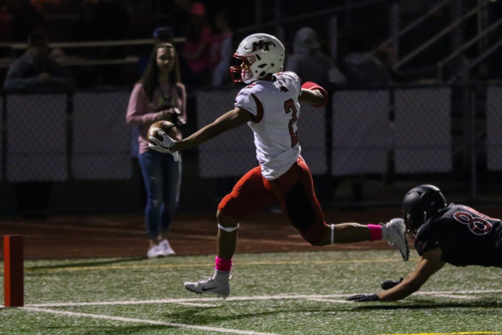 Dom Latham reaches out to put the ball across the goal line for Terrace's first touchdown