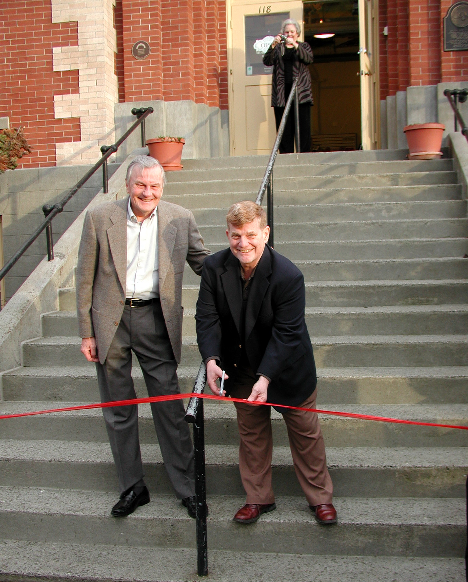 Historical Society Vice President Jack Hall and Mayor Mike Cooper cut the 100th birthday ribbon Thursday.