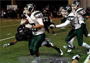 Desmond Young runs the ball last season. (Photo by Char Blankenship)