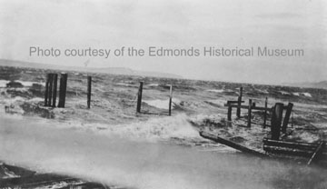 A storm causes damage to the Edmonds waterfront, 1913.