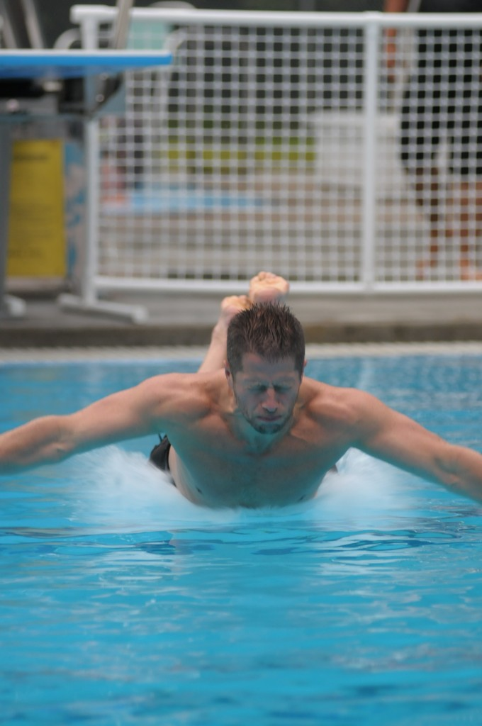 Kurt Fisher makes a splash at the 2012 Yost Pool belly flop contest. (Photo by Chad Emerson)