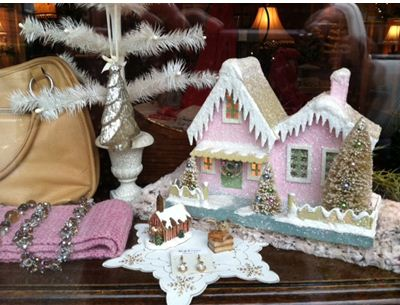 Bluefish Designs shop is decked for the Christmas Art Walk; pink house $52.