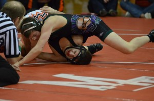Defending state champion Noah Cuzetto pins Christian Pridgeon of Monroe in the 120 lb. weight class.