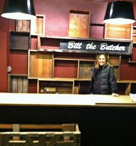 In happier times, CEO J'amy Owens readies the meat shop for its Edmonds opening.