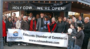 """Mayor Dave Earling joined representatives of Bill the Butcher at the Edmonds Chamber of Commerce """"ribbon chopping"""" Friday afternoon. To celebrate, the store offered grilled meat samples and prizes. Bill the Butcher is located at 323 Main St. in downtown Edmonds."""