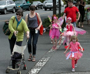 Children celebrate spring during the annual Fairy and Flower parade.
