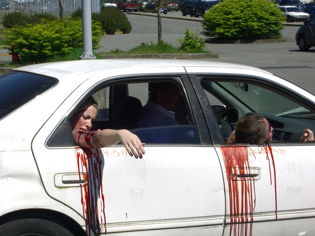 Students used fake blood to simulate the consequences of a head-on collision during Meadowdale High School's annual Prom Mock DUI event Monday at Meadowdale High School.