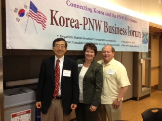 From left, Edmonds Chamber Board member Gary Choo of GTC Financial, My Edmonds News Advertising and Marketing Director Maggie Peterson and Chuck Loomis of Edmonds Community College at the Business Forum.