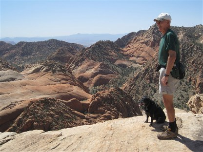 Tom hiking in the mountains with his dog.