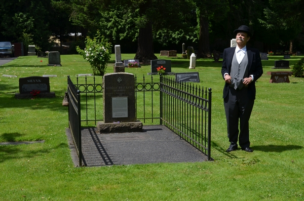 """Actor John Hartquist at the 2012 """"Walk Back in Time"""" portraying Edmonds founder, George Brackett, and standing in front of Brackett's gravesite."""