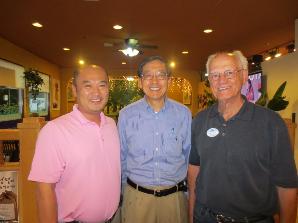 Jay Han, owner of Boo Han Market with Edmonds Chamber board members Gary Choo and Bob Rinehart. (Maggie Peterson photos)