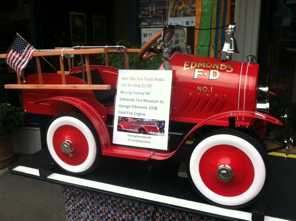 Seen in front of Caldwell Banker Bain Friday: Enter to win a fire truck pedal car; all proceeds benefit fundraising for an Edmonds Fire Museum to house historical fire trucks. (Photo by Julie Van Tosh)