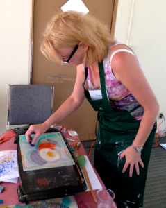 Tracy Felix creating an encaustic painting.  She will be demonstrating during Edmonds Art Walk, Thursday September 19, 5 - 8 pm.  Walking maps available at EdmondsArtWalk.org.