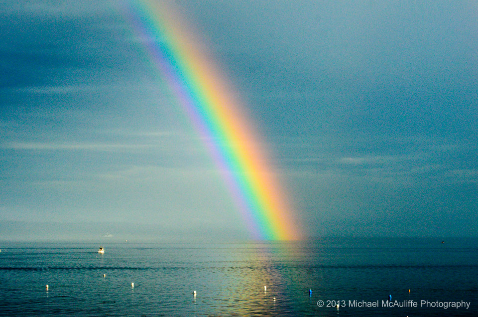 From Mike McAuliffe, a rainbow that appeared briefly this morning over the Edmonds waterfront just as the rain stopped.