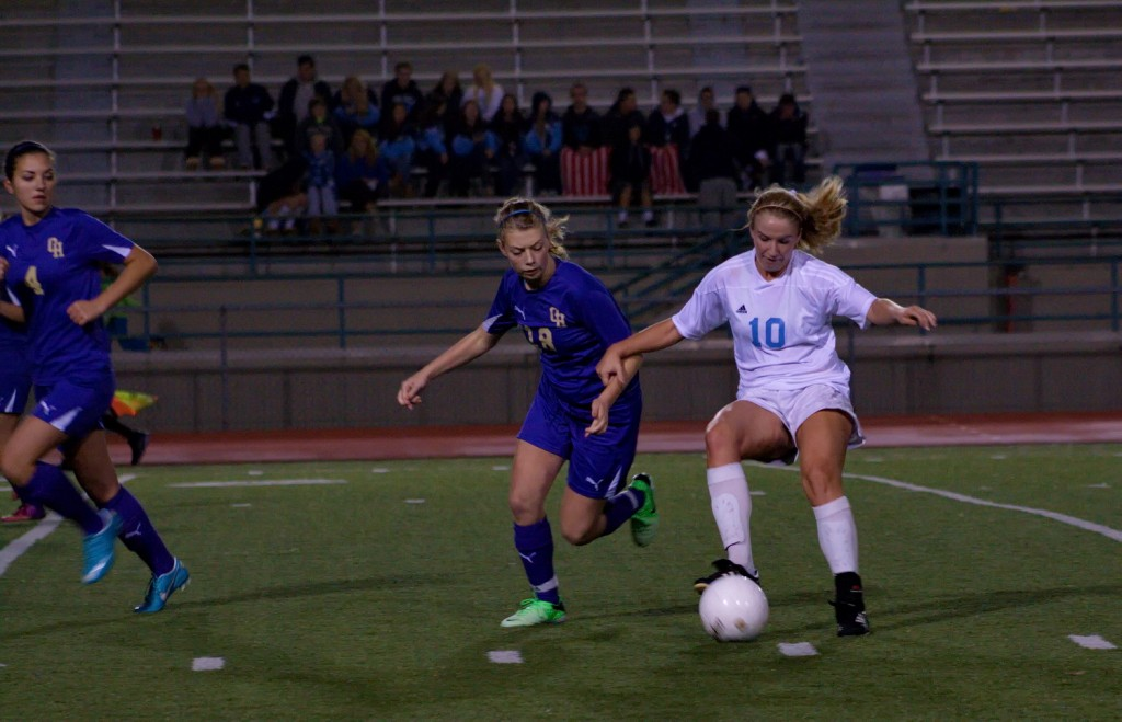 Kendall Raecker (10) of Meadowdale and Alyssa Cross (18) of Oak Harbor.