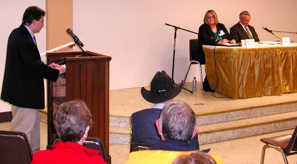 Forum moderator Rich Senderoff and candidates Adrienne Fraley-Monillas and Ron Wambolt.
