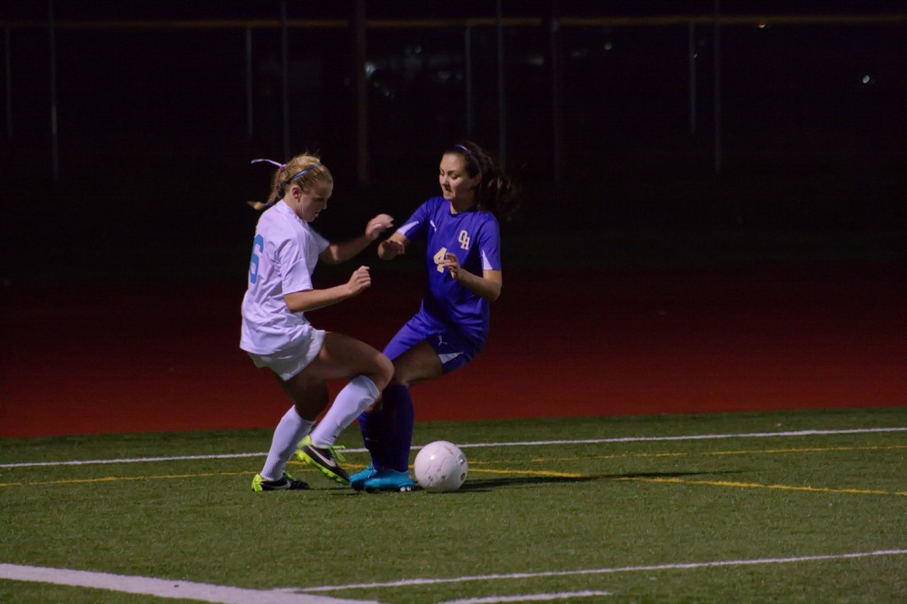 Meadowdale's Emily Crichlow, seen here battling for ball control against Oak Harbor's Jennifer Turnek, scored the winning goal in the Mavs' 1-0 win over the Wildcats Tuesday night. (Photos by Joleen Sims)
