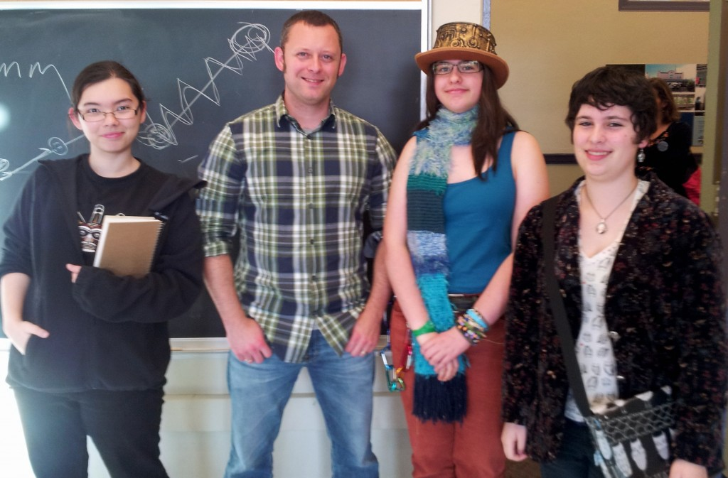 Benjamin Percy with Edmonds-Woodway High School students Jackie Kobal, Belinda Schmitz, and Dorian Grimes