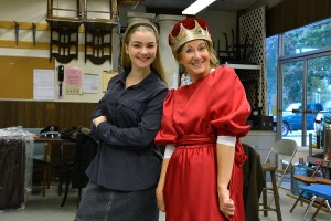Driftwood Players' Alice in Wonderland and the Queen getting fitted for their downtown Edmonds Halloween debut.