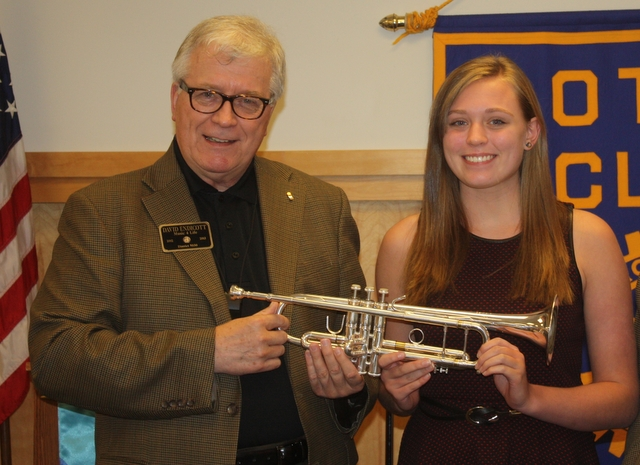 Edmonds Music4Life Chair/CEO David Endicott (left) presents the Pelland Trumpet to Lynnwood High School sophomore Kaelyn Stanton.