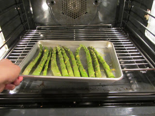 Now that the salmon is out of the oven, put the asparagus in. The time it'll take to cook the asparagus will depend on the thickness of each stalk. The asparagus I bought was quite thick, so it cooked in the 425 degree oven for about 8 minutes. If you have thinner asparagus, cook for less time. Adjust accordingly.