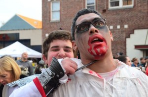 Nicholas Muth attempts to subdue zombie Alex Seiz. Doesn't he know zombies are already dead?