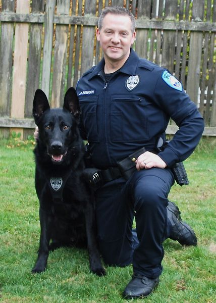 Hobbs, Edmonds' new K-9 dog, poses with handler Officer Jason Robinson.