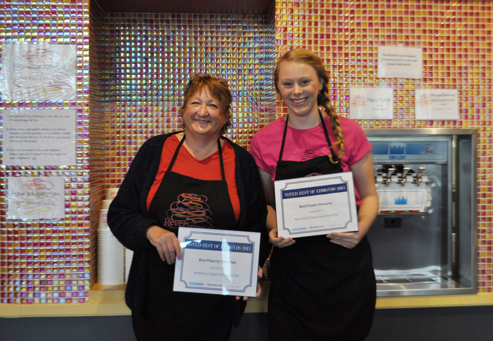 "Revelations Yogurt Laura Riddle Manager and ""key employee"" Amie Korf accept the Best Frozen Desserts award."