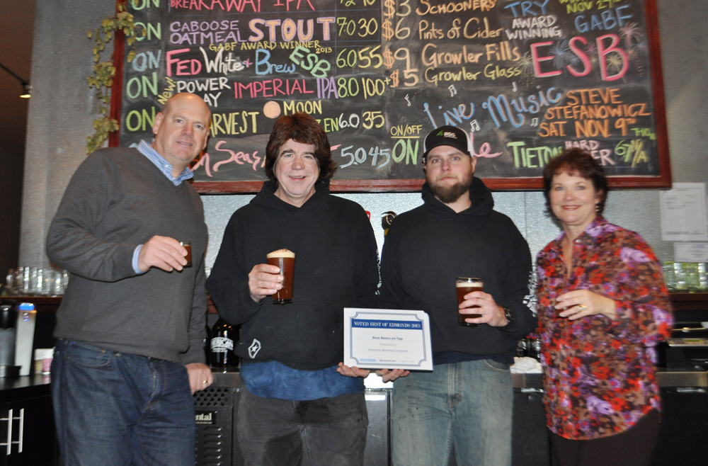 Best Beers on Tap awarded to American Brewing. Edmonds Deals Founder Peter Wilson, left, and My Edmonds News Advertising and Marketing Director Maggie Peterson, right. present to Skip Madsen and Dan Payson.